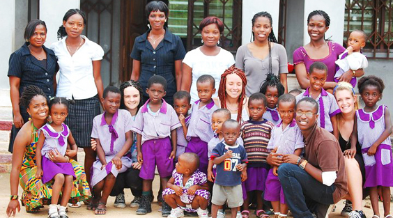 group photo of students with teachers and schoolchildren in Ghana