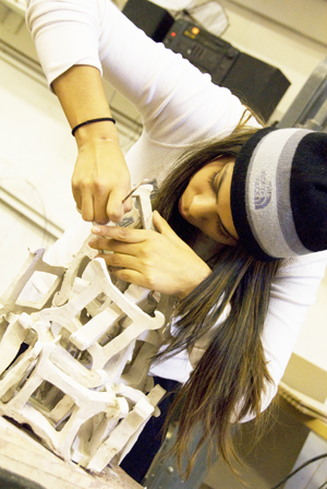 female student working on a sculpture