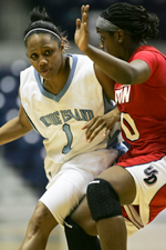 URI women's basketball player driving on a defender