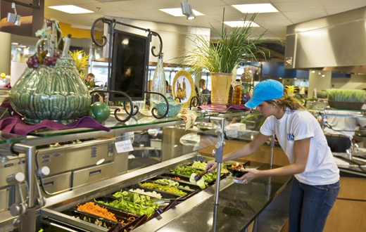 student at fresh salad bar