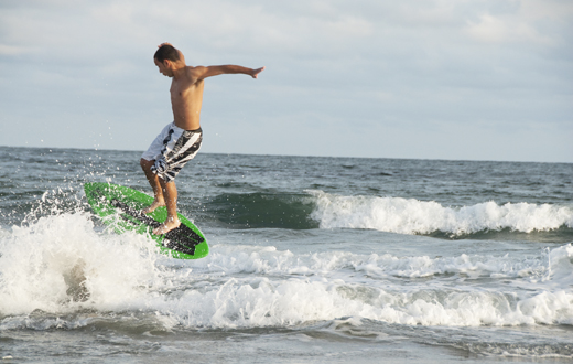 student surfing at the beach