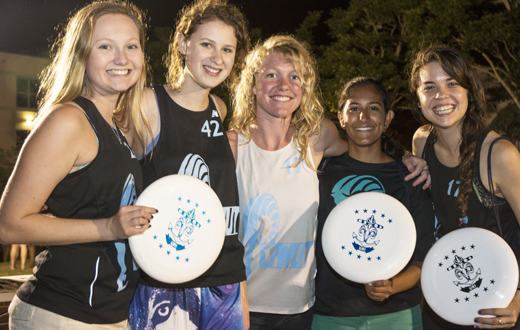 students posing with frisbees