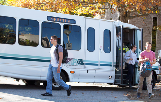 students getting off a campus shuttle bus