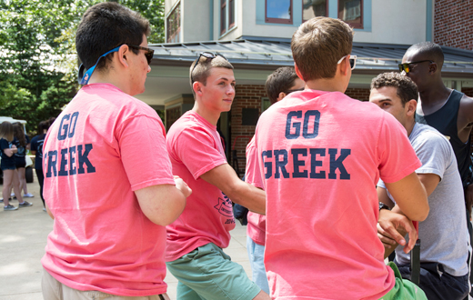 fraternity brothers wearing 'Go Greek' tee shirts