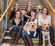 URI students training puppies to be guide dogs for blind individuals