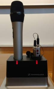 Red lights indicate the mics are charging.