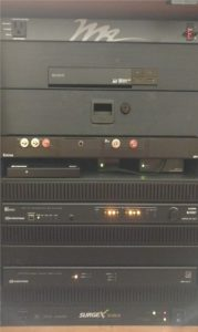 Sony DVD player located in top of media rack