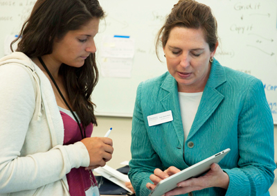 faculty member working with student using iPad