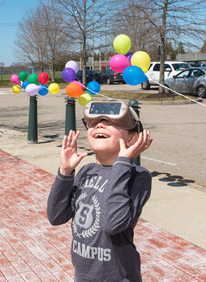 child looking at the sky through goggles