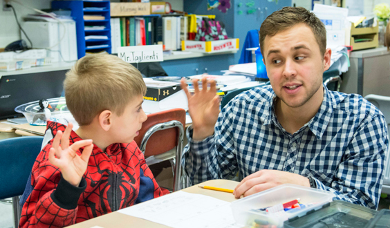 teacher working with a student