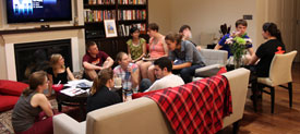 Students gathered in a dorm common area