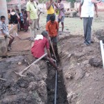 Digging a trench for water infrastructure in India
