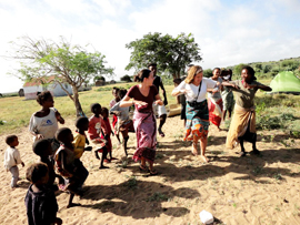 women and children dancing together