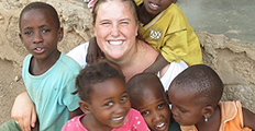 URI student with children in Africa