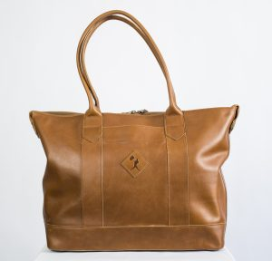 """c716c2dbe14b You'll have fashion for the runway and function for the ballpark with this  Baseballism vintage glove-leather tote ($225). Hit """"style"""" out of the park  with a ..."""