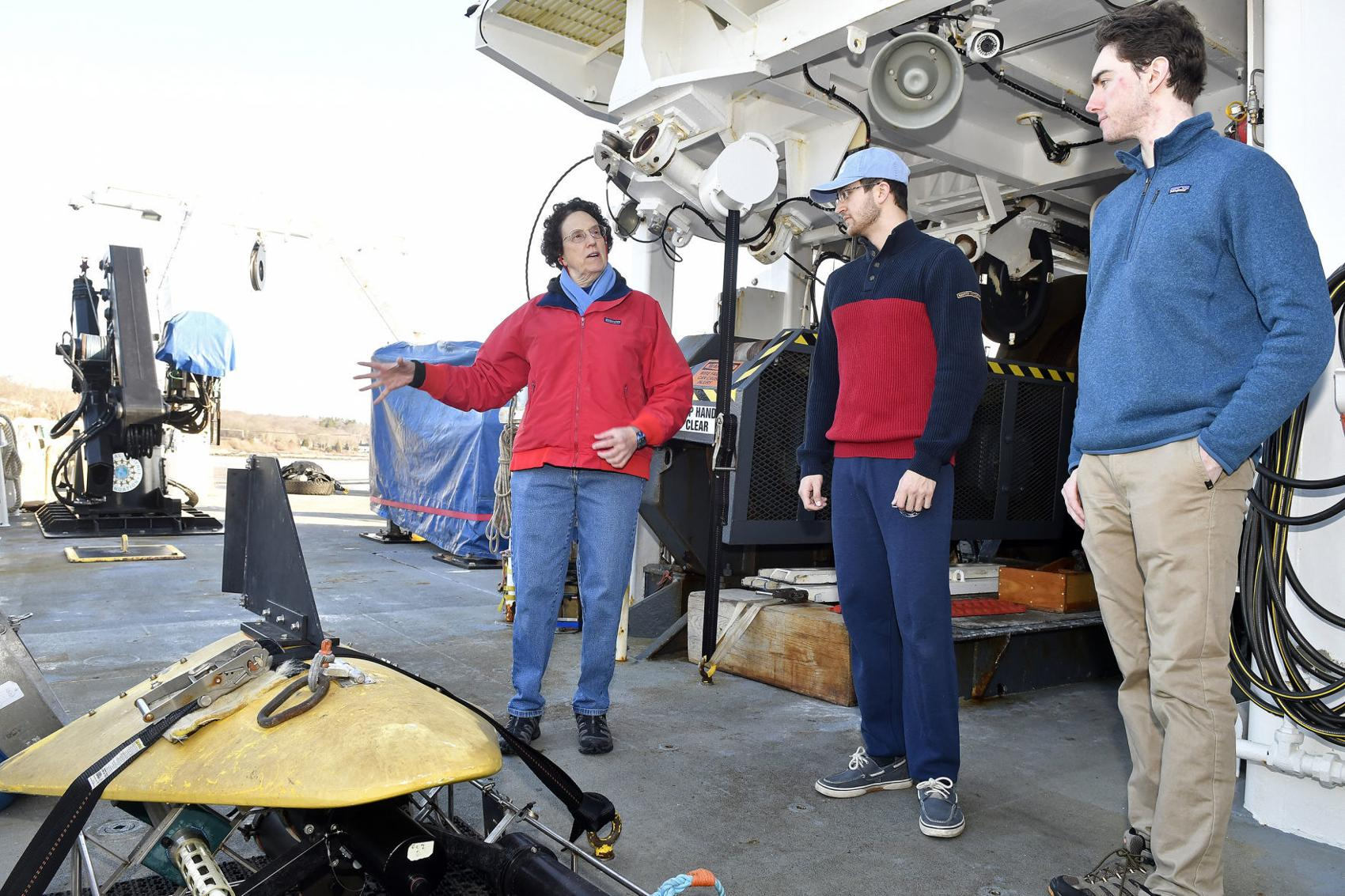 Karen Wishner, left, an oceanography professor at the University of Rhode Island, talks about the video plankton recorder aboard the R/V Endeavor with students Ethan Koproski, center, and Michael Ricker, right, Tuesday morning. Photo by Michael Derr.