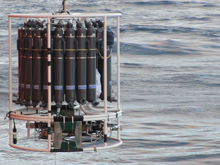 A rosette of Niskin bottles and sensors being deployed to sample Antarctic waters. Photo Maria Cases.