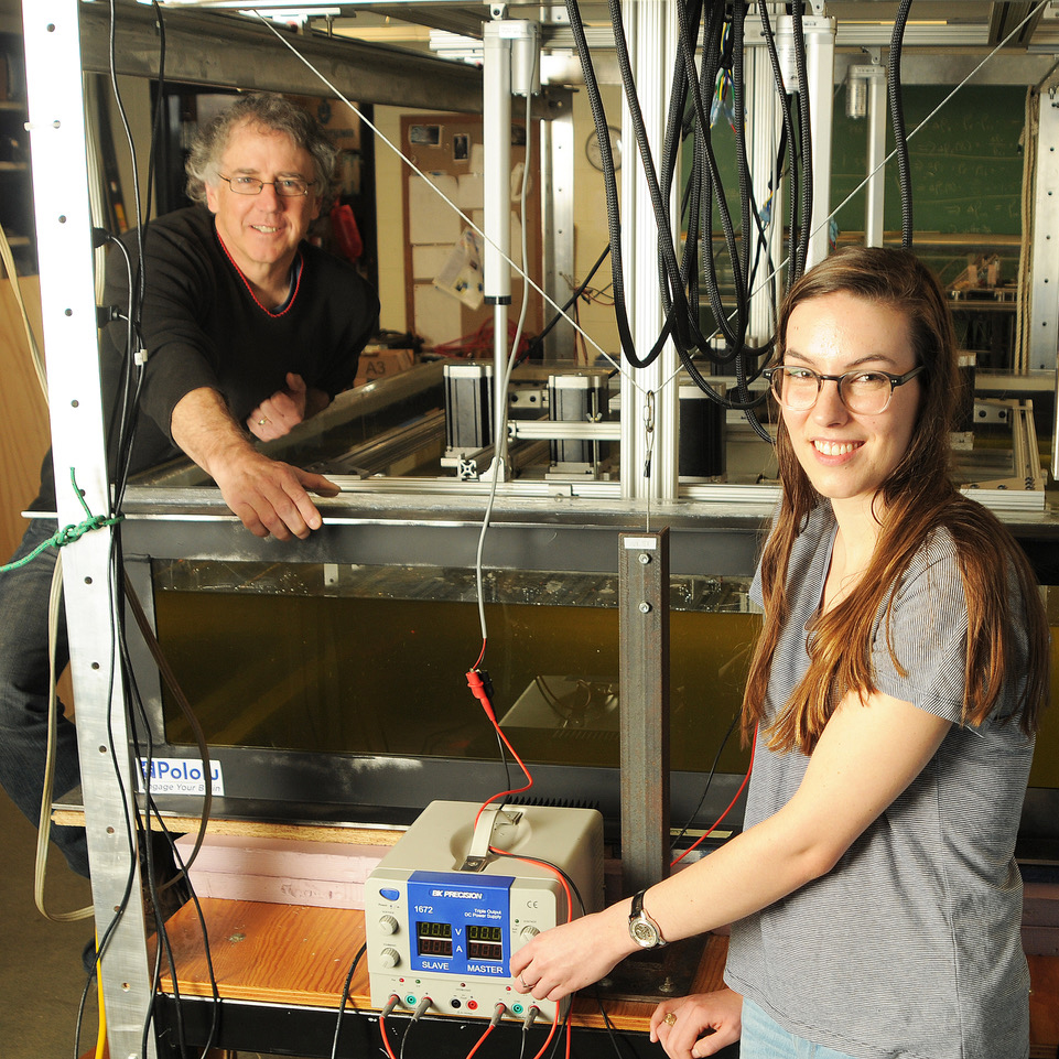 Christopher Kincaid, a professor at the Graduate School of Oceanography, and Loes van Dam, a graduate student, stand next to a corn-syrup filled apparatus to conduct experiments tectonic plates. Photo by Randy Osga.