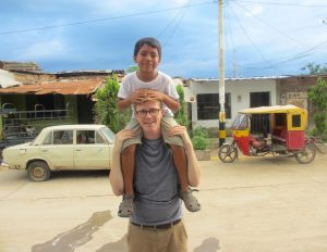 Kevin's seven-year-old 'brother', Aaron, is enjoying the view from atop Kevin's shoulders