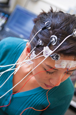person with electrodes attached to head