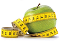green apple wrapped in measuring tape