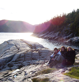 students camping by a lake in Quebec