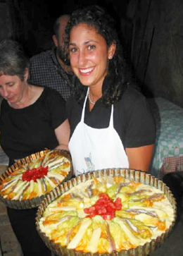 Student holding tray of colorful Greek food