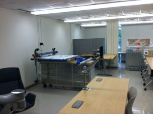 Image of large 3D Platform printer with the Curator's desk located behind it