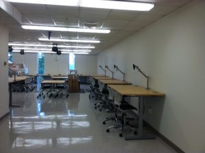 Image of collaborative computer work stations and finishing tables