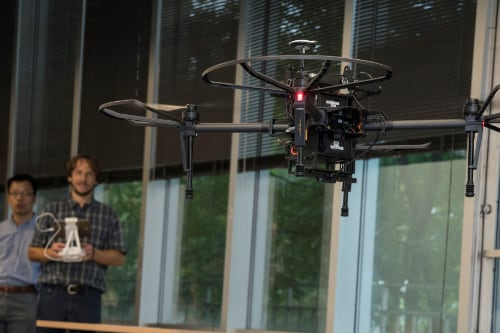 professors operate a drone in the AI Lab