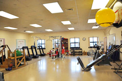 PT clinic with treadmills, weights and other equipment