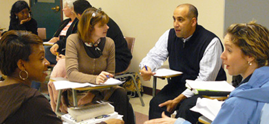 diverse students doing group work in a classroom