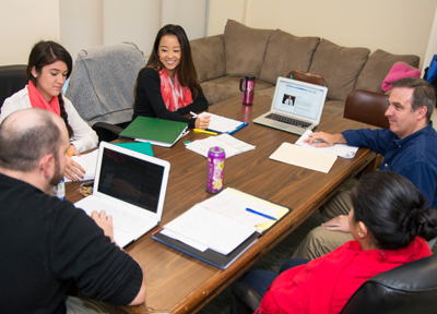 students in a group consultation
