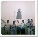 Jhumpa Lahiri with her father, Aman Lahiri (holding her), and family friends in front of the Point Judith lighthouse, early 1970s.
