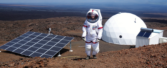 Science officer Christiane Heinicke outside the solar-powered dome on the northern slope of Mauna Loa volcano in Hawaii. Bottom left, a NASA photo of the planet Mars.
