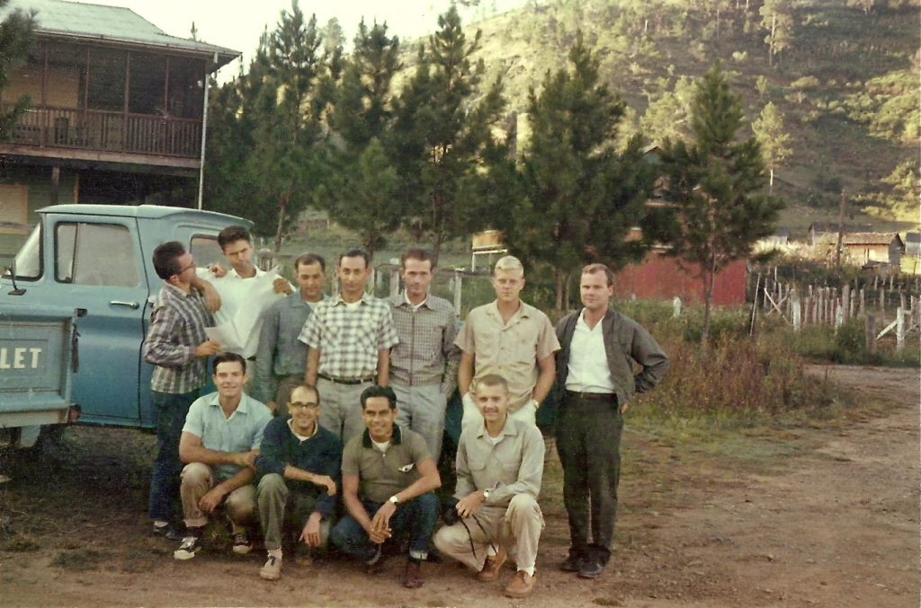 """Golly, how young and handsome."" Neil Ross, alumni coordinator for URI's Peace Corps prep program,  pictured here with his volunteer forestry group high in the mountains of the Dominican Republic in 1963. (Neil is the in the front row, on the right—the young and handsome guy kneeling with the camera.)"