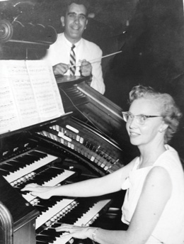 Top, Abusamra singing at commencement; above, with his wife Barbara.