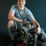 Alex Reppe with his service dog, Icey,