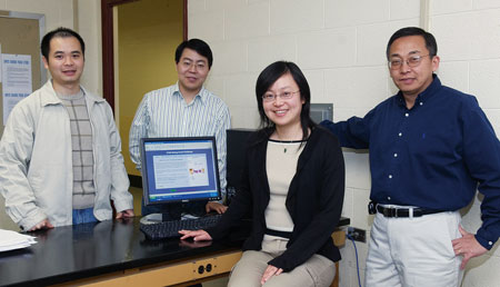 Professors Yan Sun and Quing Yang, foreground left to right, with graduate students Jin Ren, left, and Yafei Yang, who  is one of the inventors of the patent.