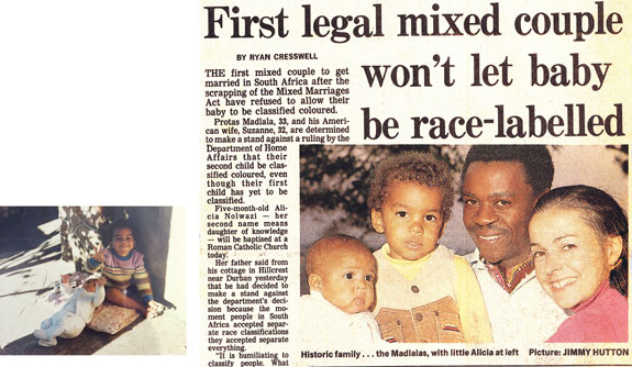 Above left, Darius with baby Alicia; at right, news clipping announcing the couple's refusal to classify their children.