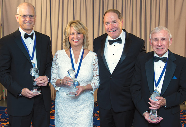 Left to right: Michael Chambrello of IGT, Laurie White '81, President David M. Dooley and George Graboys, Hon. '99
