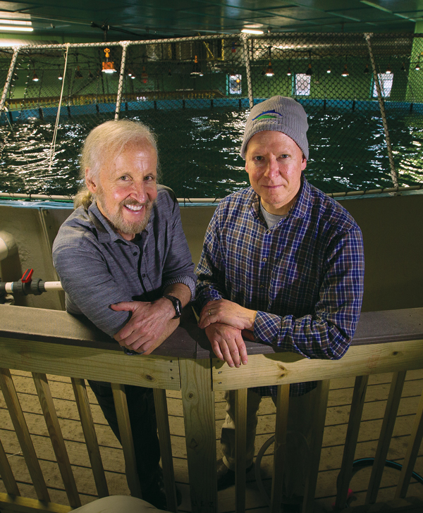 URI Fisheries Professor Terry Bradley, M.S. '79, at left, with aquaculture entrepreneur Peter Mottur '91 at their yellowfin tuna research facility on the Narragansett Bay Campus.