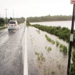 Car on flooded North Road in Jamestown, R.I., after a storm.