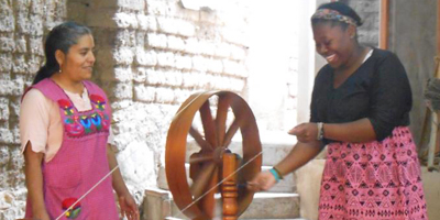 student using a spinning wheel in Mexico