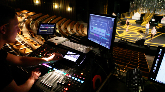 computer and sound board overlooking set for Chicago