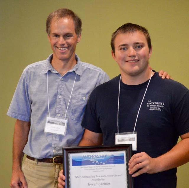 URI ocean engineering student Joseph Grenier poses with SRU Associate Professor Jameson Chace after winning the top poster award from his peers. The award came with a $100 bill.