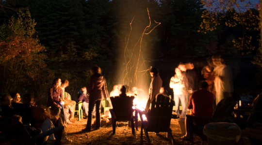 after reception gathering by the campfire