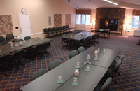 meeting room set up with tables and chairs