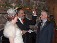 bride and groom get married in front of the fireplace